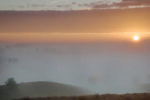 Sun rises over the fog